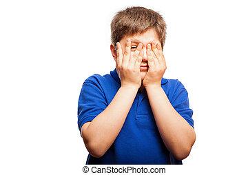 Scared little boy peeking
