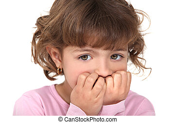 Scared little girl biting nails