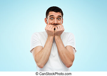 scared man in white t-shirt over blue background