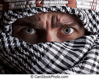 Scared middle eastern man looking to you - Portrait of...
