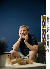 Old bearded man with alzheimer desease - Scared of all...