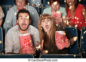Scared People Tossing Popcorn - Group of frightened people ...
