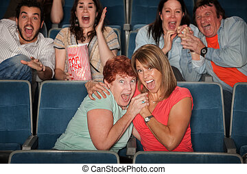 Scared People Watching Movie - Group of scared people...