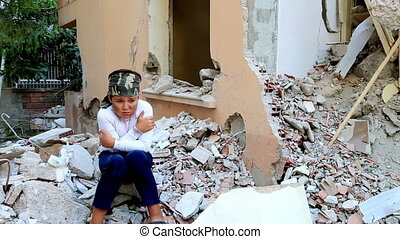 Scared, sad child in a war zone