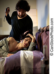 Scared sad woman being hit and abused by bad husband pulling her hair