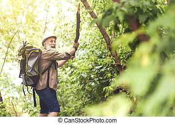 Scared senior male tourist expressing fear in the wood