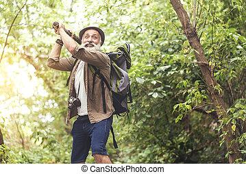 Scared senior male tourist in wild nature