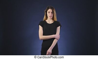scared shocked young woman on dark background