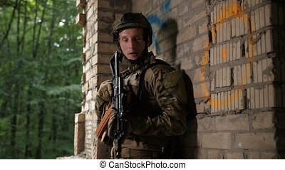 Scared special forces soldier investigating area