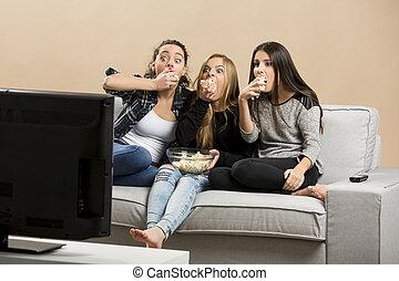 Scared teenage watching movies