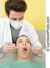scared woman at dentists office