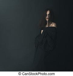 Scared woman in black  fog