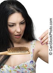Scared woman lose hair on hairbrush - Brunette woman with ...