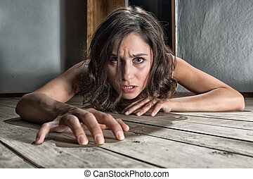 Scared woman on the floor - Scared woman crawling on the...