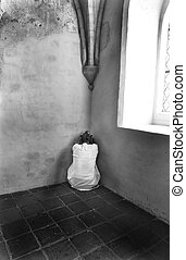 Scared woman - Scared, insanewoman hiding in a corner of an...