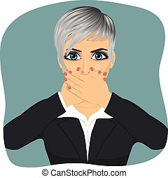 Scared young business woman covering her mouth with her hands