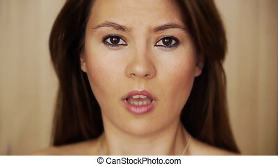 Scared young woman grimacing - Scared young woman showing...