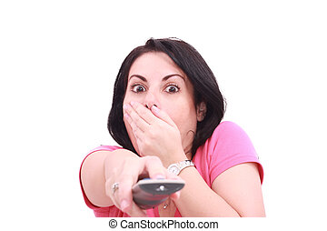 Scared young woman while watching TV in a white background