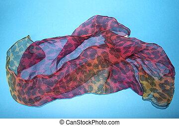 Scarf On A Blue Background - A silky print scarf on a blue ...