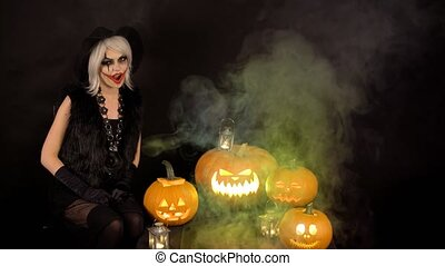 Scary beautiful girl witch growls, flirts, winks, smiles,...