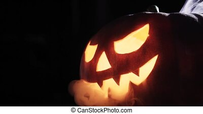 Scary carved halloween pumpkin in hot burning hell fire...
