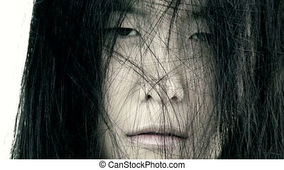 Scary closeup of ugly asian woman