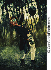 scary clown with balloon