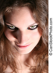 Scary creature - Dangerous looking woman with fierce yellow...