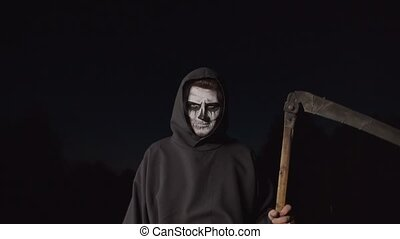 Scary death reaper with scythe creeping at dusk - Scary ...