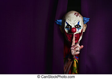 scary evil clown asking for silence - a scary evil clown...