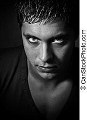 Scary eyes - Evil man with scary eyes looking from the ...