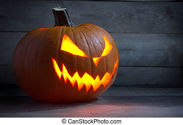 Scary face lack o lantern on wooden dark background - Scary...
