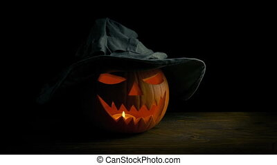 Scary Faced Pumpkin With Witches Hat - Tracking shot moving...