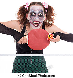 scary female clown is playing ping-pong with an eye