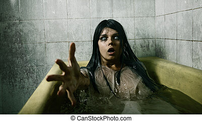 Scary girl in bath stretching her hand to camera, Halloween...