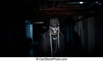 Scary guy in carnival costume of Halloween skeleton making ...
