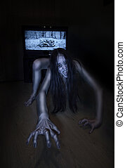 Scary Halloween photo. Dead zombie girl climbs out of the...