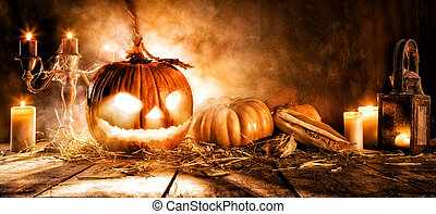 Scary halloween pumpkin on wooden planks. Empty space for...