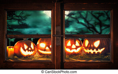Scary halloween pumpkins on wooden planks