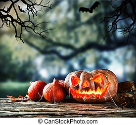 Scary halloween pumpkins with horror background