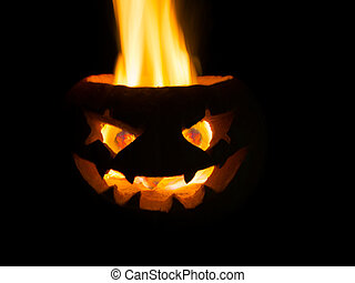 Scary head made of pumpkin. A real fire.