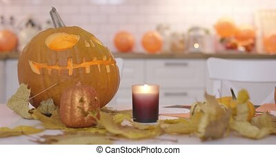 Scary jack-o-lanterns on the kitchen table - Big and small...