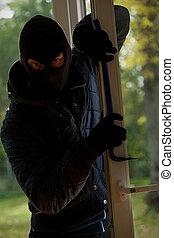 Scary masked burglar