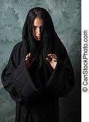 scary nun in a cape