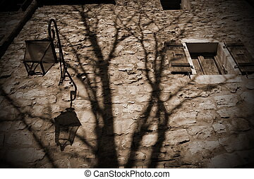 Scary old brick wall and shadow