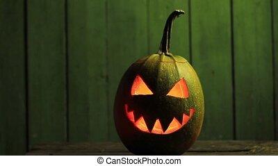 scary pumpkin face illuminated by light