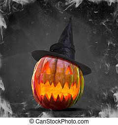 Scary pumpkin on black smoke background, the night of fear