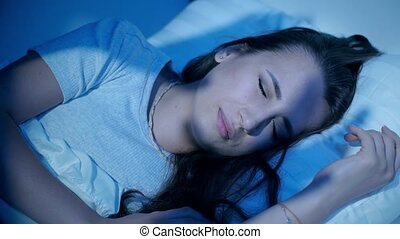 Scary shadows on a sleeping woman