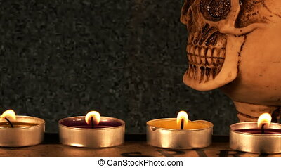 Scary Skull and Candle Light on Ouija Spirit Board