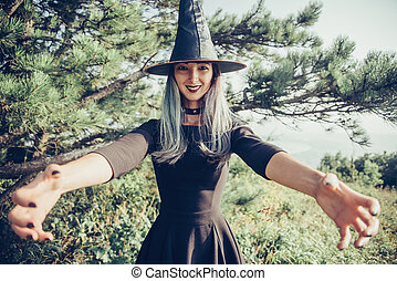 Scary witch outdoor - Scary young witch outdoor, point of...